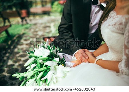 Beautiful young couple a man and a woman. Close-up hand of groom and bride with a wedding ring.  - stock photo