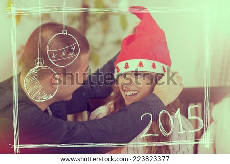 Beautiful, young couple celebrating Christmas at home - stock photo