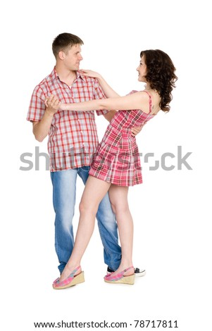 Beautiful young couple dancing. Isolated on white. - stock photo