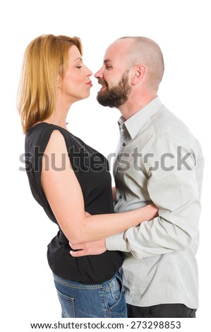 Beautiful young couple facing each other and having fun on white background - stock photo