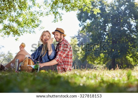 Beautiful Young Couple Having Picnic in Countryside. Happy Family - stock photo