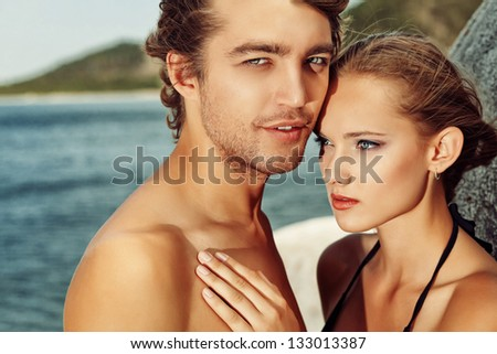 Beautiful young couple in love  having holidays on the sea. - stock photo