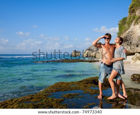 Beautiful young couple on vacation near the ocean - stock photo