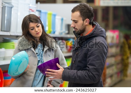Beautiful Young Couple Shopping For Bowl In Produce Department Of A Grocery Store - Supermarket - Shallow Deep Of Field - stock photo