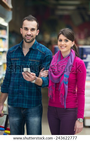 Beautiful Young Couple Shopping For Fruits And Vegetables In Produce Department Of A Grocery Store - Supermarket - Shallow Deep Of Field - stock photo
