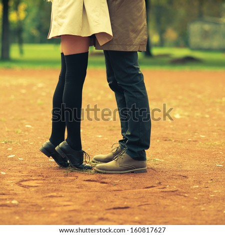 beautiful young couple tenderly kissing - stock photo