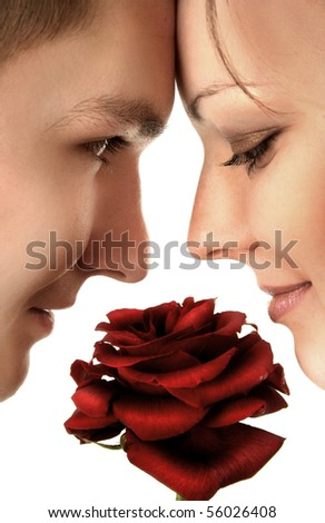 beautiful young couple with red rose - stock photo