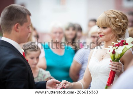 beautiful young curly blonde bride and stylish groom on the background lviv - stock photo