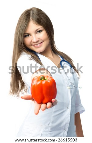 beautiful young doctor wearing white uniform giving us a red pepper - stock photo