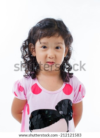 Beautiful young elementary age school girl over white with long curly black hair in summer clothes. - stock photo