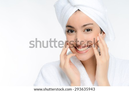 beautiful young ethnic woman in white peignoir isolated on a white background - stock photo
