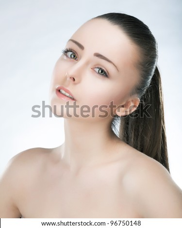 Beautiful young face of lovely woman with clean fresh skin and natural make up - stock photo