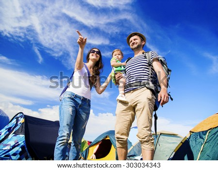 Beautiful young family at summer music festival   - stock photo