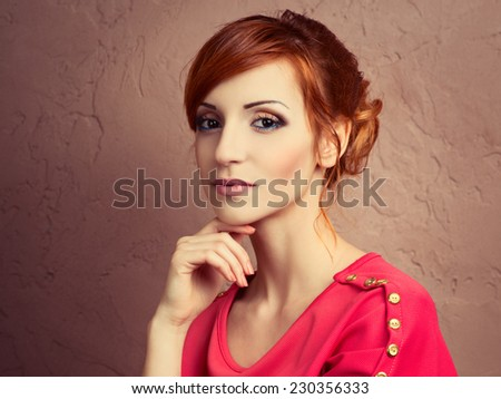 Beautiful young fashionable woman posing in red dress, smiling, looking at camera. Vogue Style - stock photo
