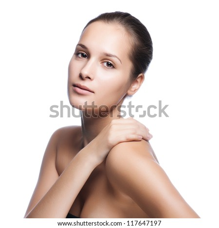 Beautiful young female face with a wellness complexion - isolated on white - stock photo