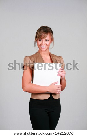 beautiful young female in business clothes holding white binder - stock photo