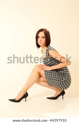 Beautiful Young Female Model in Isolated Studio Setting - stock photo