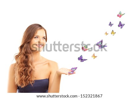 Beautiful young female with many colorful butterflies isolated on white background - stock photo