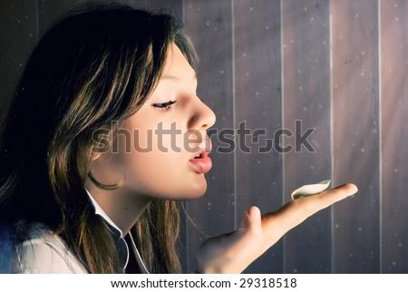 Beautiful young girl blow away rose petal - stock photo