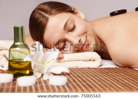 Beautiful young girl does spa treatments - stock photo