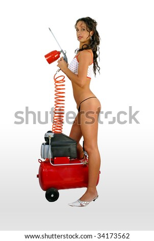 Beautiful young girl dyer with sexy lingerie and dyer gun. - stock photo