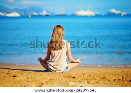 Beautiful young girl enjoying her vacation by the sea  - stock photo