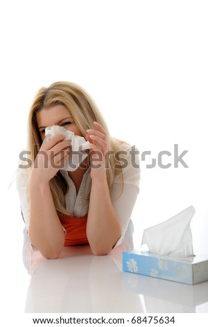 Beautiful young girl having a flu with paper tissues on the floor. isolated on white background - stock photo