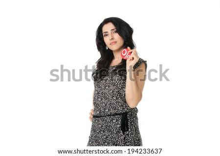 Beautiful young girl holding discount symbol in her arms isolated background - stock photo