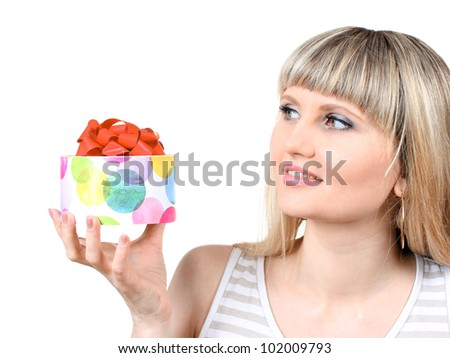 Beautiful young girl holding gift isolated on white - stock photo