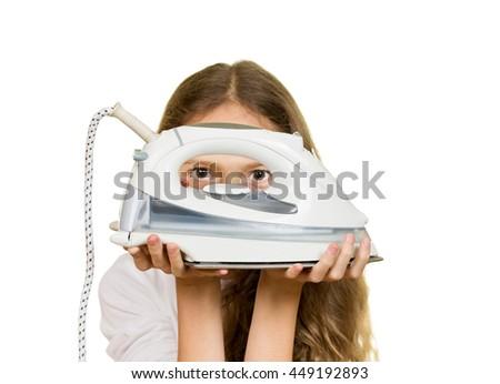 Beautiful young girl holding iron isolated on white background - stock photo