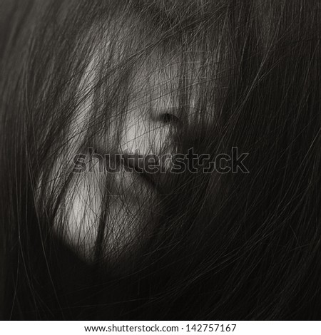 beautiful young girl in a mask of hair - stock photo
