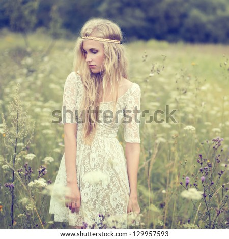beautiful young girl in a summer field - stock photo