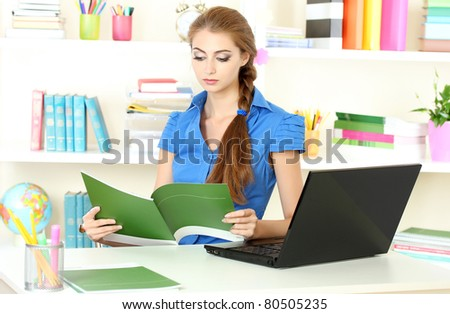 beautiful young girl in the office - stock photo