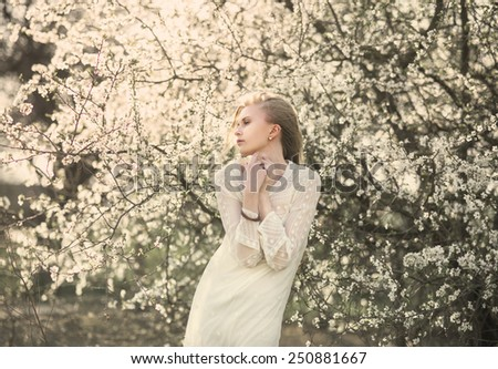 beautiful young girl in the spring in the forest - stock photo