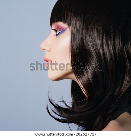 Beautiful young girl in the studio face in profile close-up, beauty concept - stock photo