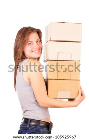 Beautiful young girl is going to move into a new house - stock photo