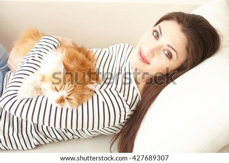 Beautiful young girl is relaxing with pet - stock photo