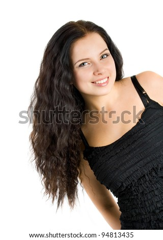 beautiful young girl looks in the frame - stock photo