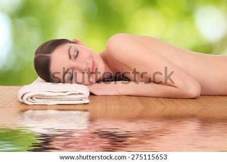 beautiful young girl lying in a spa - stock photo