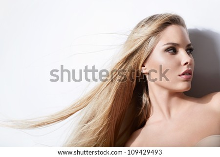 Beautiful young girl on a white background - stock photo