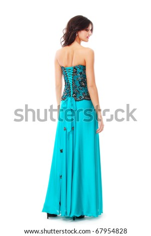 Beautiful young girl posing in blue fashionable dress on white background standing backside - stock photo