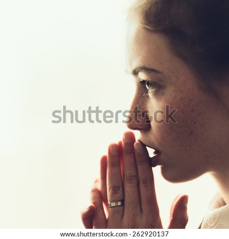 beautiful young girl prays - stock photo
