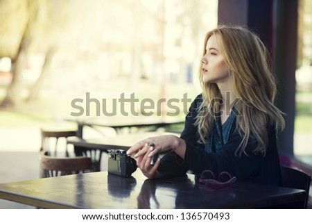 beautiful young girl resting in a cafe - stock photo