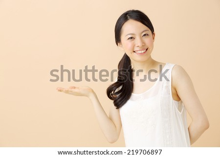 beautiful young girl showing copy space,  - stock photo