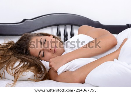 Beautiful young girl sleeping in bed in her bedroom - stock photo