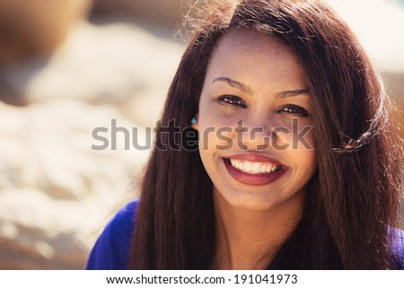 Beautiful young girl smiling in nature  - stock photo