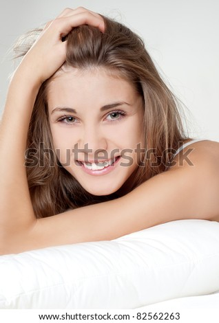 beautiful young girl spending the morning in bed - stock photo