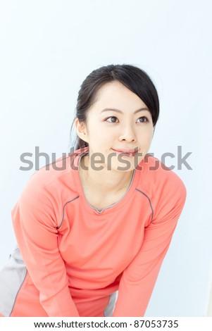 beautiful young girl stretching - stock photo