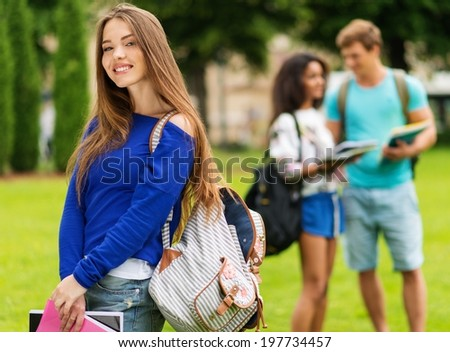 Beautiful young girl student in a city park on summer day  - stock photo