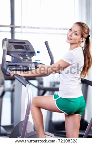 Beautiful young girl who is engaged in fitness - stock photo